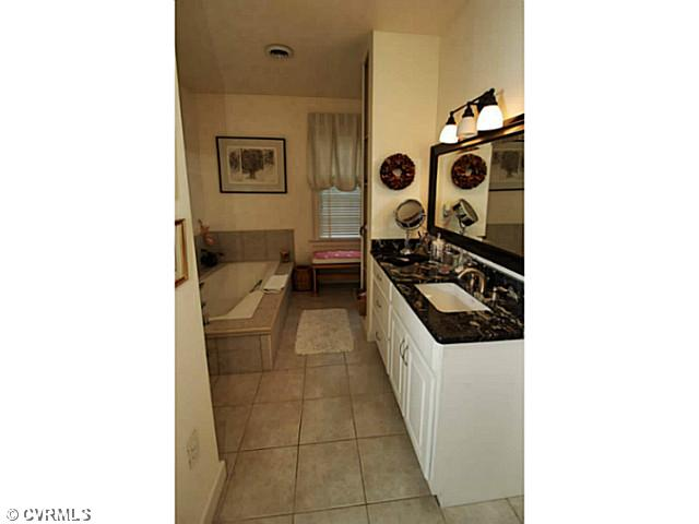 Master Bath - With separate shower and tub with ceramic tile sur ...